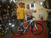 Scott Caygill presenting Raffle winner Ian Hewitt with his new bike. A very happy man. Enjoy Ian!